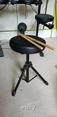 Alesis DM6 electronic drum kit including amplifier and sticks