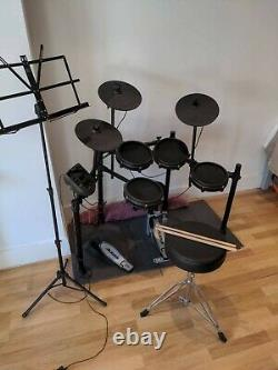 Alesis Nitro Mesh Electronic Drum Kit with Mesh Pads, Drum Throne, Music Stand