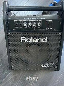 Roland Electronic Drum Kit with stool, pedal and amp